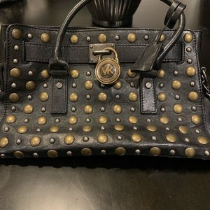 Authentic Micheal Kors black bag with gold studs